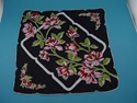 Picture of 1950s Vintage Hankie In A Sheer Black Fabric With Large Bright Red Flowers.